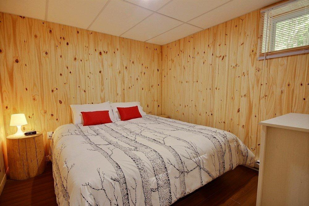 Chalet en bois rond L'Aigle-Noir - Chambre principale