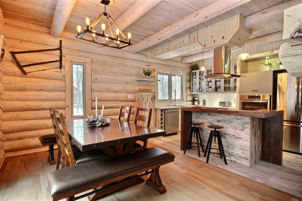 Chalet en bois rond Le Perce-Neige - Foyer intérieur