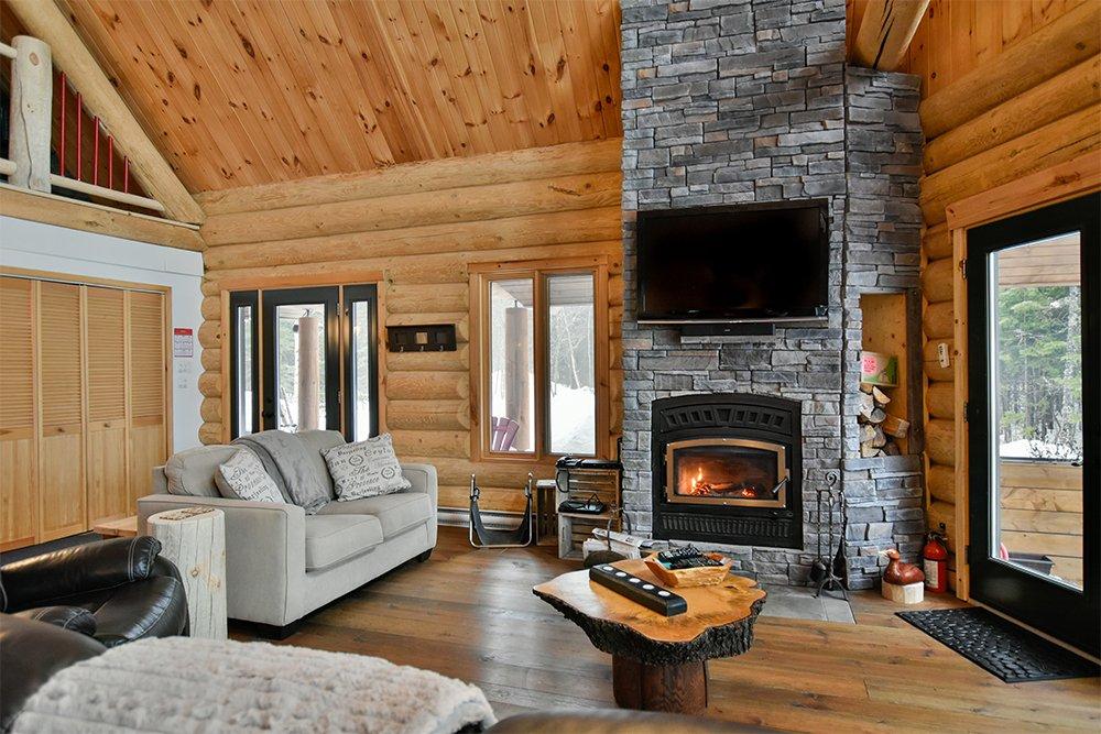 Chalet en bois rond Le Pinecone - Foyer