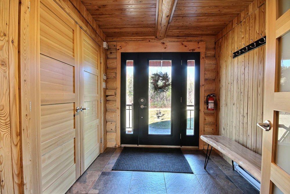 Chalet en bois rond Le Chasse-Galerie - Hall d'entrée
