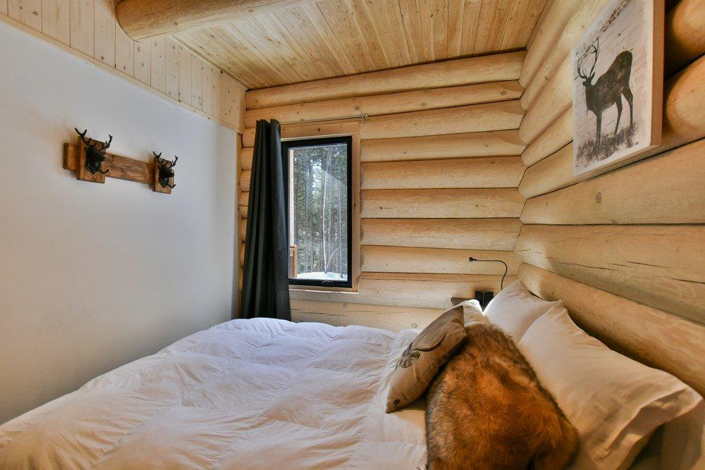 Chalet en bois rond Le Panache - Grande Chambre