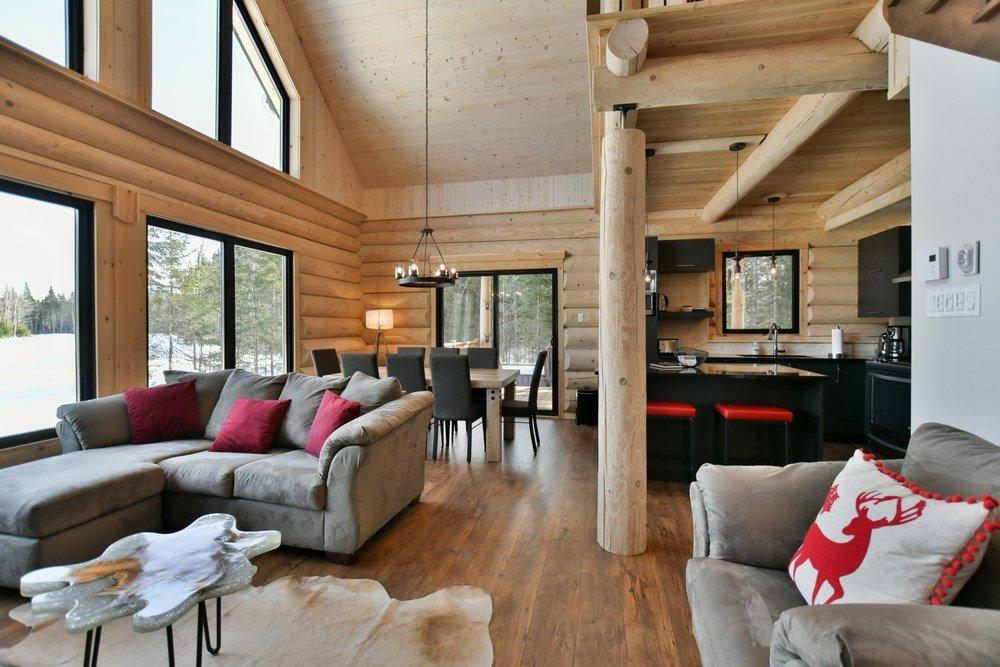 Chalet en bois rond Le Panache - Aire Ouverte