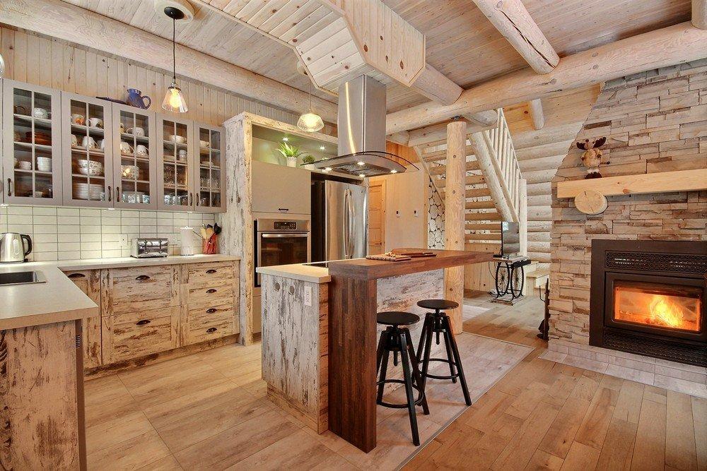 Chalet en bois rond Le Perce-Neige - Salle à manger et foyer