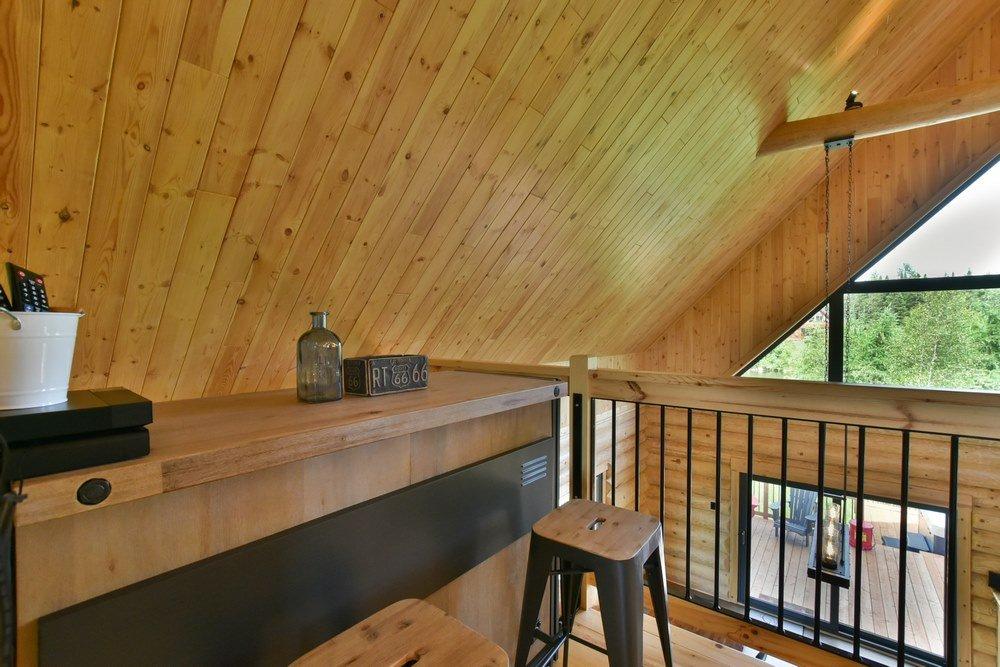 Chalet en bois rond Le Perséides - Bar sur la mezzanine