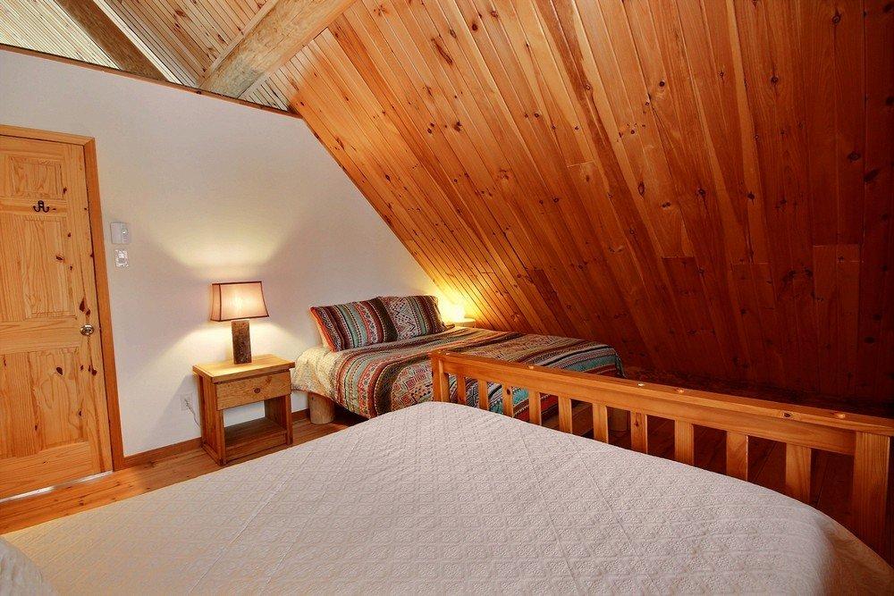 Chalet en bois rond Le Pinecone -  Chambre avec 2 lits-1