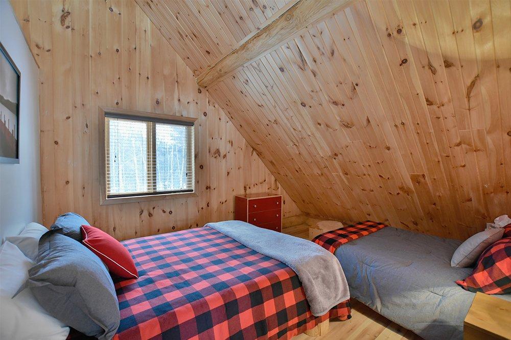 Chalet en bois rond Le Pinecone - Chambre avec 2 lits-2