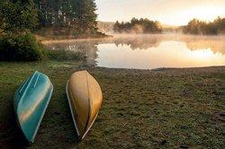 Canoe on the beach at sunrise