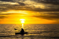 Sea kayaking at sunset, Forillon Park