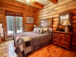Chalet bois rond - chambre